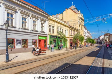Miskolc, Hungary - April 28, 2018: People walking on main street of Miskolc, Hungary.
