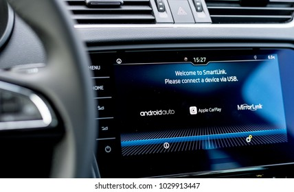 MISKOLC, HUNGARY - FEBRUARY 17, 2018: On board computer in a modern car displaying available phone connection services like Android Auto and Apple CarPlay