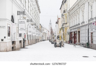 MISKOLC, HUNGARY - JANUARY 05, 2019: Snowfall in the city center of Miskolc at the National Theater of Miskolc on Deryne Street leading to Minorite Church