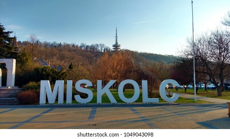 Miskolc, Hungary - March 23, 2017: Miskolc Sign with TV Tower in the background.
