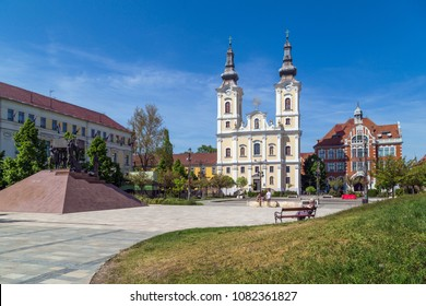 MISKOLC,HUNGARY -APRIL 28,2018 :Heroes Square in Miskolc downtown. Church of the Assumption or Minorite Church is the most significant church in the city,and the High School building.