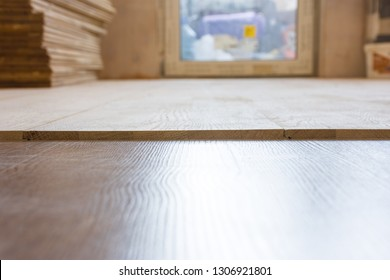 Mismatch levels surfaces when laying a floor - wooden parquet or laminate floor - in the building