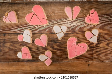 Mismatched Broken Heart Cookies over wooden background