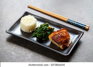 Miso marinated black cod with Japanese spinach salad gomaae