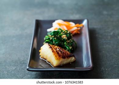 Miso marinated black cod with Japanese spinach salad gomaae