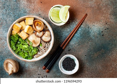 Miso and soba noodles soup with kale, shiitake mushrooms, 