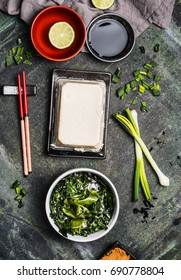 Miso soup cooking ingredients on rustic vintage background, top view. Asian food or Japanese cuisine concept