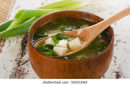 Miso soup on white wooden table. Selective focus