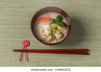 miso soup with rice cakes and vegetables japanese foods (zouni)
