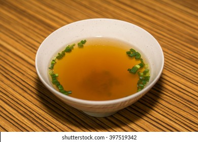 Miso soup in a round cup on a wooden table, Miso soup is delicious in a spherical cup placed on a wooden table.