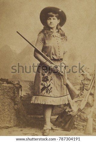 Miss Annie Oakley in 1885, the year she and husband Frank Butler joined BUFFALO BILLS WILD WEST. At five feet tall, Oakley was given the nickname of Watanya Cicilla by fellow performer Sitting Bull, w