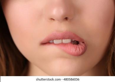 Miss biting her lip. Close up