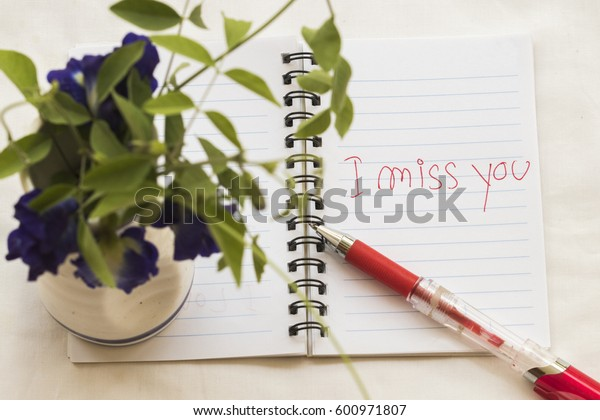 i miss you message card write on notebook with flowers romantic