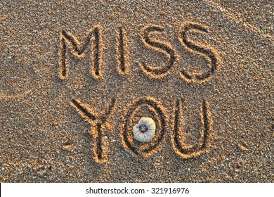 """""""MISS YOU"""" message on the beach"""