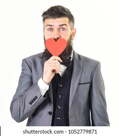 Miss you, Valentines day, te amo, love me. Declaration of love. I love you concept. Mature man with long beard and cheerful face. Happy bearded man holds red heart. Hipster wears smart suit.