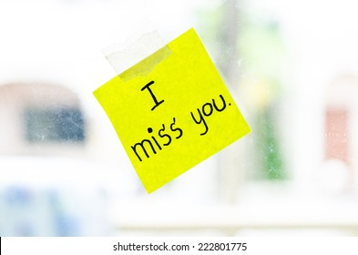 I miss you word sticky note on window mirror