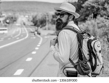 Missed his bus. Tips of experienced traveler. Man bearded hipster tourist at edge of highway. Pick me up. Traveler waiting for car take him anyway just to drop at better spot.