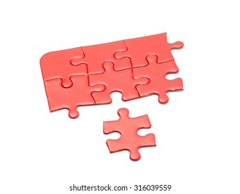 Missing jigsaw puzzle piece red color, business concept for completing the final puzzle piece