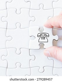 Missing jigsaw puzzle piece with symbol TELEPHONE. Business concept image for completing the puzzle.