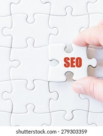 Missing jigsaw puzzle piece with word SEO. Business concept image for completing the puzzle.