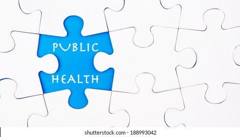 Missing jigsaw puzzle pieces revealing the PUBLIC HEALTH words