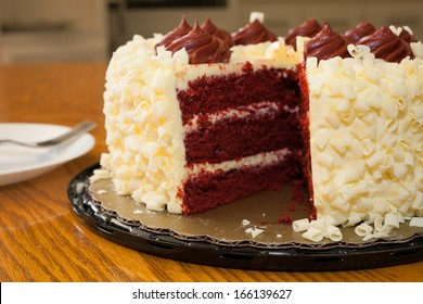 Missing piece of the red velvet cake on the table