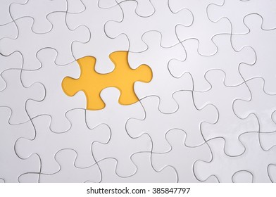 Missing Puzzle on Yellow Background, Searching a Solution and Business Concept