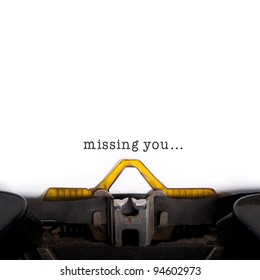 """""""Missing you"""" message typed by vintage typewriter."""