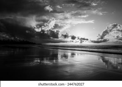 mission beach sunrise in high contrast black white