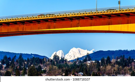 Mission Bridge over the Fraser River on Highway 11 between the towns of Abbotsford and Mission in British Columbia, Canada with Mount Robie Reid over the town of Mission
