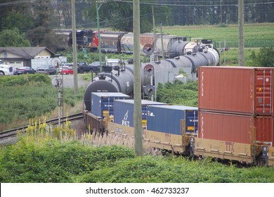 MISSION - JULY 30, 2016: A wide assortment of goods are transported by Canadian National Railway near Mission, BC on July 30, 2016.