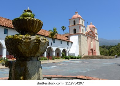 Mission in Santa Barbara, California on a sunny day with fountain on foreground