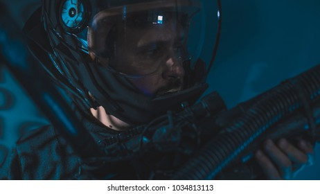 Mission, space man with led lights helmet, space suit and gun in the shape of a cannon
