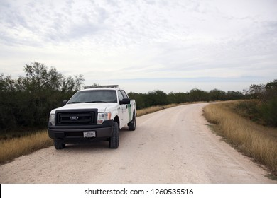 Mission, Tx/U.S. - Dec. 12, 2018:  A Border Patrol agent parks on a levee where the  border wall is to be built through the National Butterfly Center in February, cutting off about a third.