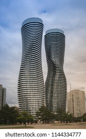 MISSISAUGA, CANADA - JULY 28, 2018:  Absolute World Towers or Marilyn Monroe Towers - Skyscrapers contominium complex, on a cloudy sky background  after rain