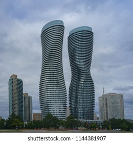 MISSISAUGA, CANADA - JULY 28, 2018:  Absolute World Towers  or Marilyn Monroe Towers  - Skyscrapers contominium complex, on a cloudy sky background  - panoramic