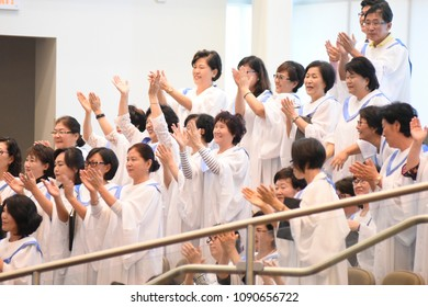 MISSISSAUGA - AUGUST 13:  People singing and clapping to celebrate Pastor Hyeon Soo Lim's return to his own church from North Korean captivity on August 13 2017 in Mississauga, Canada.