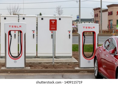 MISSISSAUGA, CANADA - April 23rd, 2019: Two Tesla Supercharger Stalls in Tesla's Mississauga Supercharger Station.