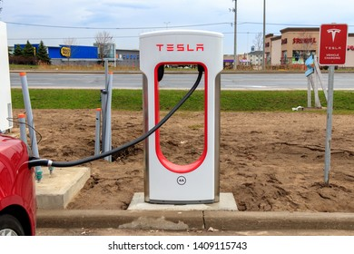 MISSISSAUGA, CANADA - April 23rd, 2019: Newly Installed Tesla Supercharger Stall in Mississauga, Ontario.