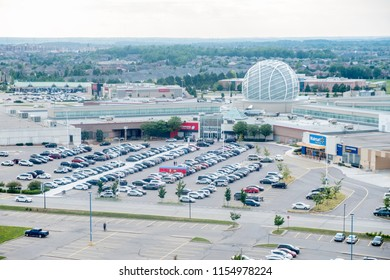 Mississauga, Canada - August 11, 2018: View of Erin Mills Town Centre and Its Parking Lots filled with Cars