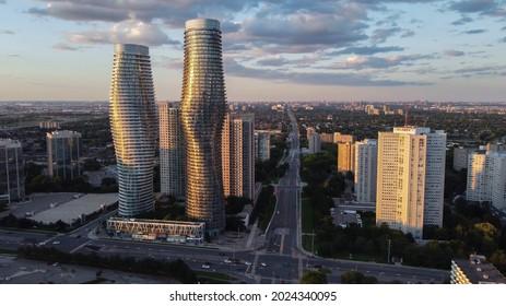 Mississauga, Canada - August 2, 2021: Aerial view of downtown Mississauga, Ontario, Canada landmark Absolute buildings condominiums. Looking east down Burnhamthorpe Road towards Hurontario Street.