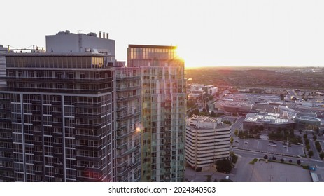 Mississauga, Canada - August 2, 2021: Aerial shot of downtown Mississauga during late afternoon before sunset on a summer day. City Centre, city hall high-rise condominiums and Square One mall.