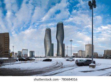 MISSISSAUGA, CANADA - DECEMBER 23, 2017: Beautiful View of the Absolute World Residential twin tower buildings in the city on a cold and snowy day