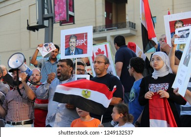 MISSISSAUGA / CANADA - JULY 6, 2013: A crowd of Egyptian protesters in Mississauga, Canada, speaking out against the coup and outing of Egyptian president Mohamed Morsi.