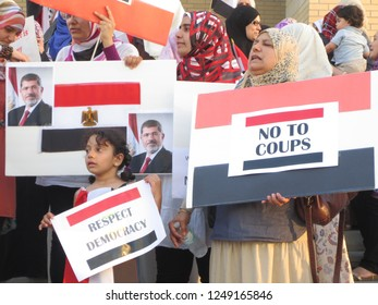 MISSISSAUGA / CANADA - JULY 6, 2013: Mother and girl in crowd of Egyptian protesters in Mississauga, Canada speaking out against the coup and outing of Egyptian president Mohamed Morsi.