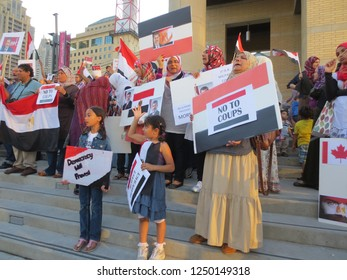 MISSISSAUGA / CANADA - JULY 6, 2013: A crowd of a hundred or so Egyptian protesters in Mississauga, Canada speaking out against the coup and outing of Egyptian president Mohamed Morsi.
