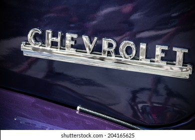 "MISSISSAUGA, CANADA - JULY 6 2014: Chevrolet Advance Design Truck logo on a purple painted model. As seen at ""Classics on the Square"", a car show in Mississauga, Canada on July 6, 2014."