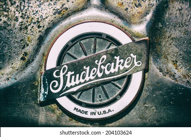 """MISSISSAUGA, CANADA - JULY 7 2014: Emblem on the front of a classic Studebaker automobile.  Seen at """"Classics on the Square"""", a car show at Celebration Square in Mississauga, Canada on July 6, 2014."""