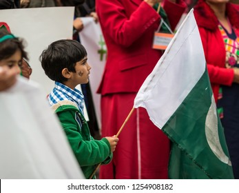 MISSISSAUGA, CANADA - OCT 5, 2014: Young boy Pakistani protest. Members of the Pakistani community in Mississauga, Canada protest against Nawaz Sharif, the  then Prime Minister of Pakistan.