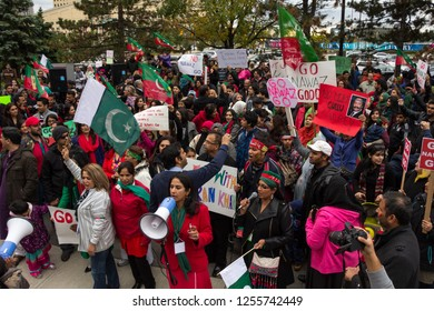 MISSISSAUGA, CANADA - OCT 5, 2014: Members of the Pakistani community protest against Nawaz Sharif, the Prime Minister of Pakistan in Mississauga, Canada.